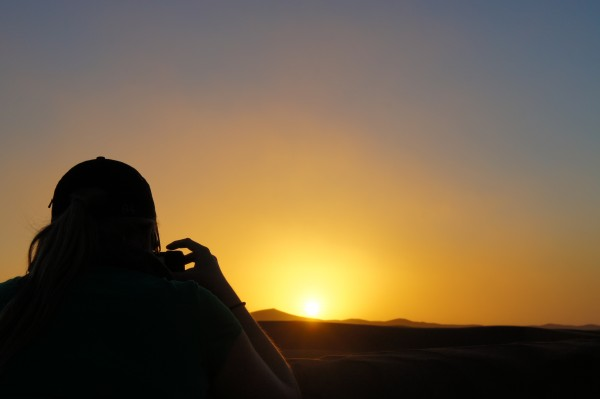 Climbing sand dunes in Morocco to get a photo of the sunset