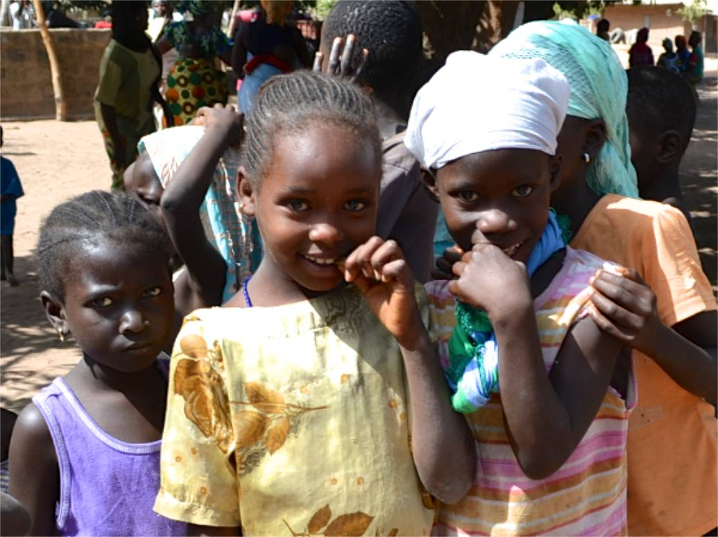 Shy smiles in The Gambia