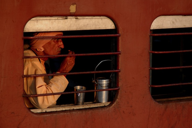 man on a train in India