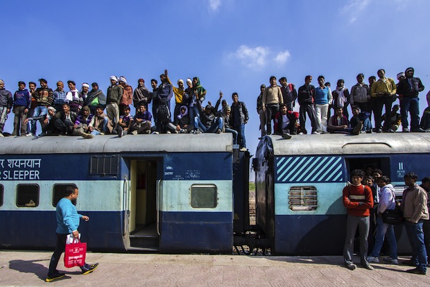 people standing on a train in India