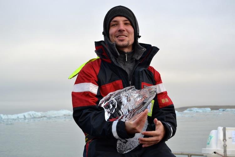 Icelandic man holding ice