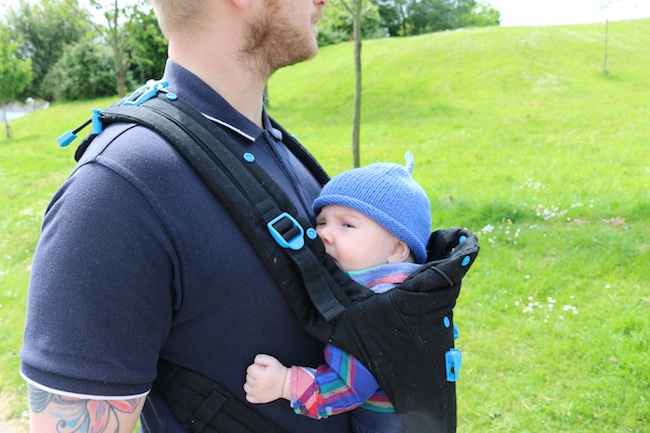 Baby in Pao Papoose baby carrier