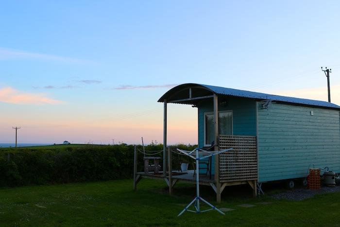 Shepherd huts at sunset in Swansea Bay