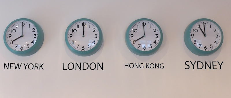 Clock wall displaying different time zones