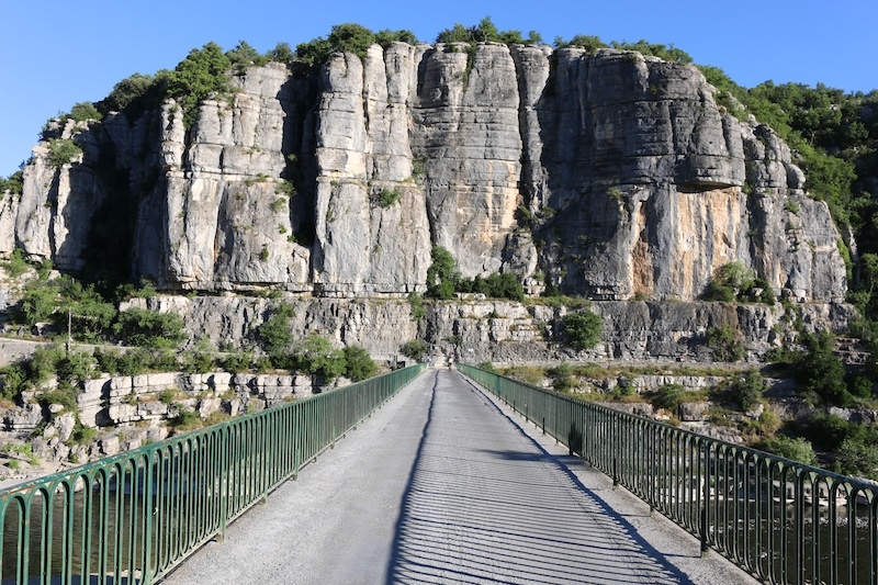 Walking over the bridge in Balazuc