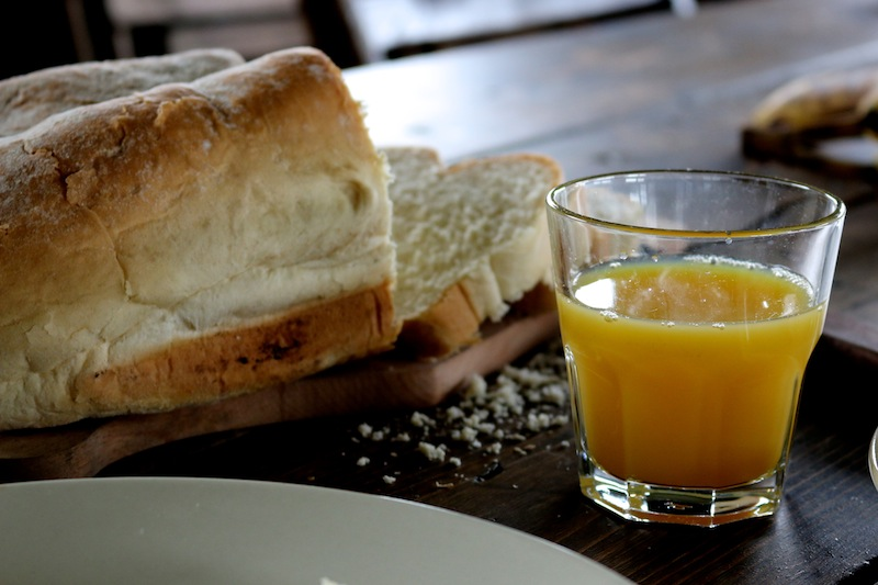 Featherdown Glamping in Lancaster - bread and orange juice from breakfast hamper