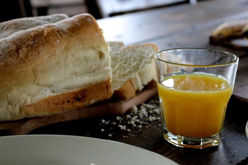 Featherdown Glamping in Lancaster - bread and orange juice from breakfast hamper