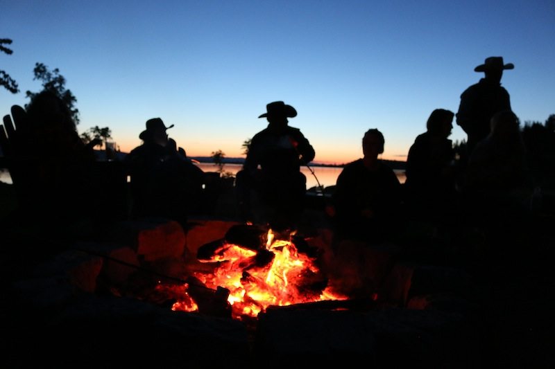 cowboys-around-the-campfire-at-flathead-lake-lodge
