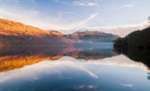 A misty Loch Lomond at sunrise.